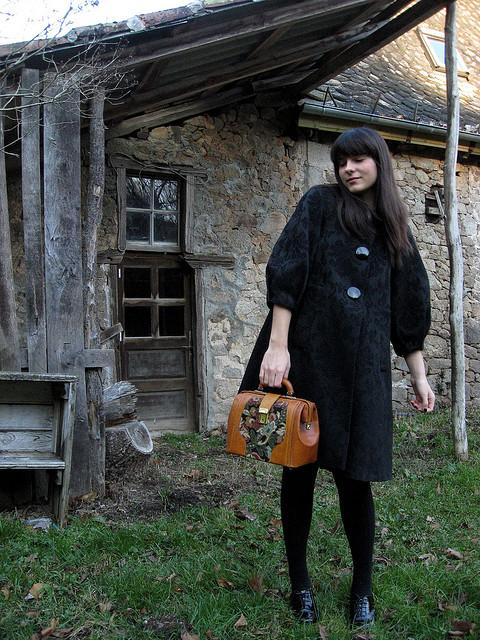 Mary Poppins bag and black coat via- The Cherry Blossom Girl