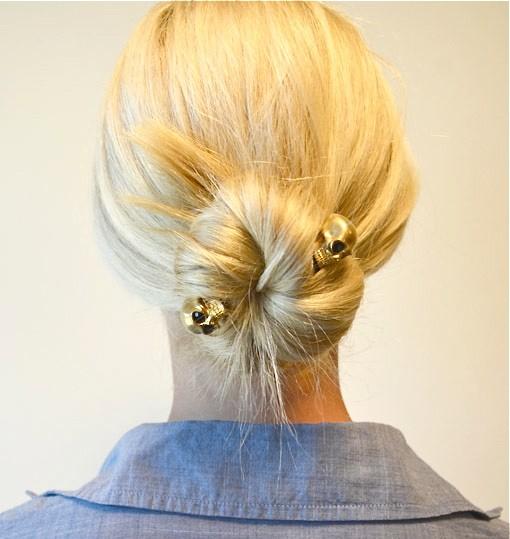 via-NM Daily, Cusp merchandise coordinator Alison Gross wears an Alexander McQueen skull brooch in her hair.